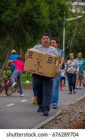 Quito, Ecuador - April,17, 2016: Unidentified people carrying food, clothes, medicine and water for earthquake survivors in the coastfor