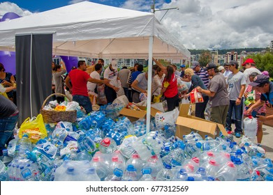 Quito, Ecuador - April,17, 2016: Unidentified citizens of Quito providing disaster relief water for earthquake survivors in the coast