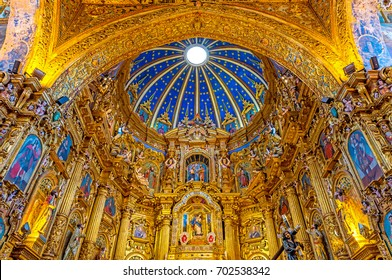 QUITO, ECUADOR - AUGUST 18, 2017: The Virgin of Quito located in the main altarpiece of the San Francisco Church and convent with blue dome and gold decorations in the historic city center.