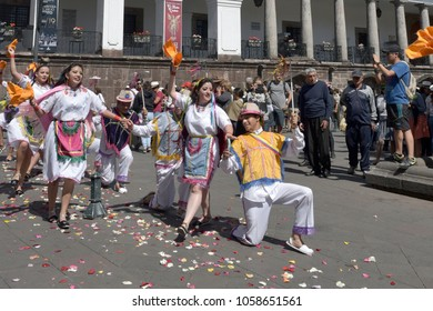 Quito, Ecuador - December 17: People in traditional Ecuadorean dresses dance as part of a parade through the Independence Square front of the Carondelet Palace (is the seat of government)