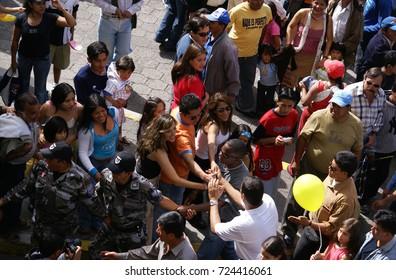 QUITO, ECUADOR - DECEMBER 31, 2006: Rafael Vicente Correa Delgado, ecuadorian politician on the nationwide rally after election of President of Ecuador on Amazonas ave, a front of hotel Hilton Colon.