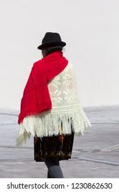 QUITO, ECUADOR, FEBRUARY 24: Rear view of indigenous Ecuadorian woman dressed with the traditional clothes. Ecuador 2015