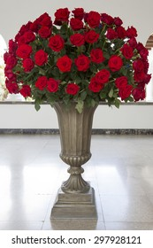 QUITO, ECUADOR, FEBRUARY 26: Huge bunch of red roses in stone vase located in the Presidential Palace, Quito. Ecuador 2015.