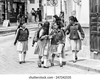 QUITO, ECUADOR - JAN 1, 2015: Unidentified Ecuadorian students in a school uniform. 71,9% of Ecuadorian people belong to the Mestizo ethnic group