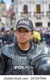 QUITO, ECUADOR - JAN 1, 2015: Unidentified Ecuadorian police woman in special costume. 71,9% of Ecuadorian people belong to the Mestizo ethnic group