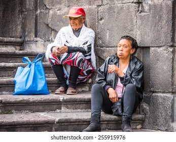 QUITO, ECUADOR - JAN 2, 2015: Unidentified Ecuadorian women on the stairs. 71,9% of Ecuadorian people belong to the Mestizo ethnic group