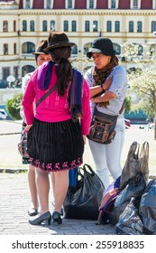 QUITO, ECUADOR - JAN 2, 2015: Unidentified Ecuadorian women with bowler hats. 71,9% of Ecuadorian people belong to the Mestizo ethnic group