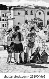 QUITO, ECUADOR - JAN 2, 2015: Unidentified Ecuadorian women with bowler hats. 71,9% of Ecuadorian people belong to the Mestizo ethnic group