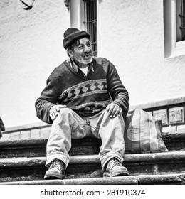 QUITO, ECUADOR - JAN 2, 2015: Unidentified Ecuadorian man with a bag on the stairs. 71,9% of Ecuadorian people belong to the Mestizo ethnic group