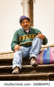 QUITO, ECUADOR - JAN 2, 2015: Unidentified Ecuadorian man with a bag on the stairs. 71,9% of Ecuadorian people belong to the Mestizo ethnic group