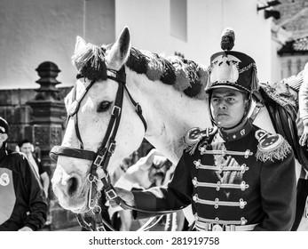 QUITO, ECUADOR - JAN 5, 2015: Unidentified Ecuadorian hussar with a horse during a parade in Quito 71,9% of Ecuadorian people belong to the Mestizo ethnic group