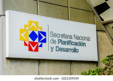 Quito, Ecuador - January 02, 2017: Outdoor view of a sign words of national secretariat for planning and development with the logo in the wall of a building, located in the city of Quito, Ecuador