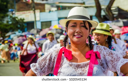 Quito, Ecuador - January 31, 2018: Close up of unidentified woman wearing indigenous clothes during a parade in Quito, Ecuador