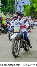 Quito, Ecuador - January 31, 2018: Unidentified man wearing a police uniform and driving a motorcycle during a parade in Quito, Ecuador