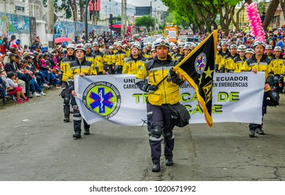 Quito, Ecuador - January 31, 2018: Outdoor view of unidentified students of hospitalary atentions and emergency, holding in their hands an informative banner during a festival parade in Quito, Ecuador