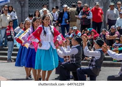 QUITO, ECUADOR - Jun 11, 2016: Group in local costume performing ecuadorian traditional dance - Quito, Ecuador