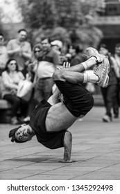 """Quito, Ecuador - March 2. 2019: Street dance in Quito, practicing some variants such as """"Locking, Hip Hop, Breaking, Popping and House"""" for the enjoyment of passers-by and tourists"""