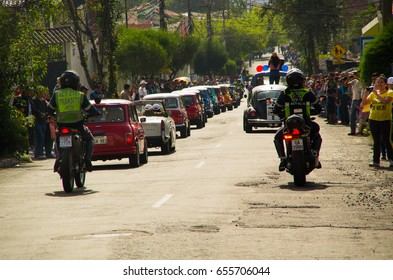 Quito, Ecuador - May 06, 2017: A parade of a group of cars before start the wood car racing inside of the streets of Quito city