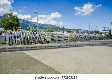 QUITO, ECUADOR- NOVEMBER, 27, 2017: Beautiful outdoor view of new boulevar in mainstreet in Amazonas avenue with a water entertainment structure with a buildings structure and mountain behind, in the