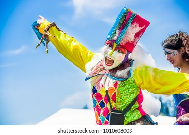 QUITO, ECUADOR- NOVEMBER, 28, 2017: Close up of unidentified happy man wearing a clown costume at a foam party at Quito festival