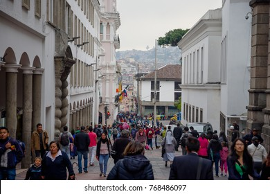 QUITO, ECUADOR NOVEMBER, 28, 2017: Crowd of people walking at historical center of old town Quito in northern Ecuador in the Andes mountains, Quito is the second highest capital city in the world