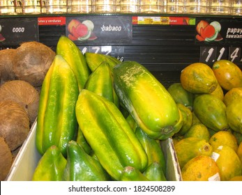 Quito, Ecuador, November 7, 2014: Babaco fruit and coconuts on a supermarket stand