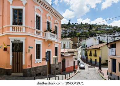 QUITO, ECUADOR - OCTOBER 27, 2015: A typical street scene in the colourful La Ronda area of historic Quito, Ecuador with the famous winged Virgin Mary statue, Loma El Panecillo, in the distance