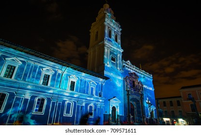 Quito, Pichincha Ecuador - August 9 2017: Close up of spectacle of lights projected on the facade of Church of Santo Domingo, with a blue light, during the Quito light festival