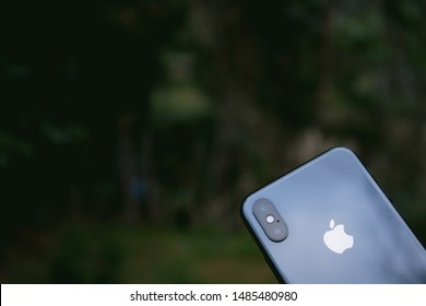 Quito-Ecuador, August 16, 2020. IPHONE XS the glass cover with the company's brand on a green background.