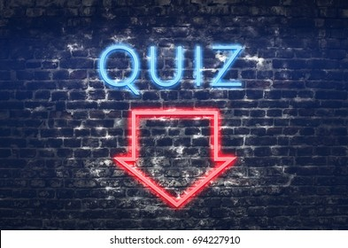 Quiz neon sign on dark brick wall background