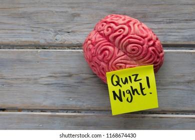 Quiz night label stuck on a brain