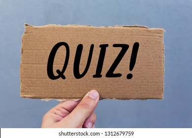 Quiz text on a cardboard - Business Concept