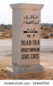 QUMRAN - DECEMBER 14: Stone Signpost directing to Qumran Caves on December 14, 2008. It was the place where the earliest surviving copies of the Holy Bible where found between 1946 and 1956 .