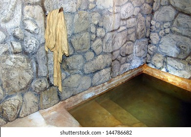 QUMRAN, ISR - SEP 27:Ancient mikvah on September 27 2007.It's a bath used for the purpose of the ritual immersion in Judaism according to the Jewish family purity law.