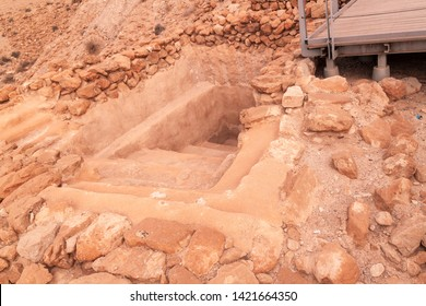 Qumran, Israel - June 5 2019 The site of Khirbet Qumran is located in the West Bank, and is the place where the Dead Sea Scrolls were found on 1947 Ritual bath, Mikveh