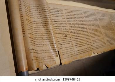Qumran, Israel - May 10 2019:  Hebrew scroll found near the Dead sea, selective focus