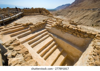 QUMRAN, ISRAEL - OCT 15, 2014: Tourists are visiting the excavations and ruins of Qumran in Israel close to the Dead Sea