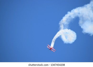 Quonset Point, Rhode Island May 30, 2015: Oracle Aerobatic Bi-plane performing a corkscrew maneuver
