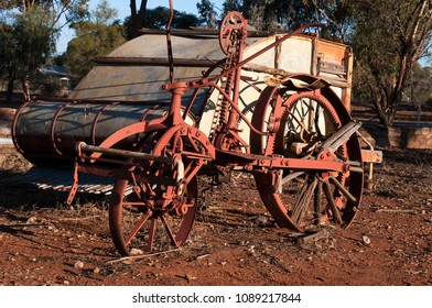 Quorn South Australia, obsolete crop harvester left to rust in the afternoon sunlight