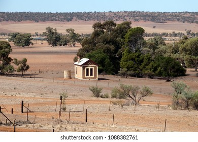Quorn South Australia, view across bare plain to rolling hills with small farmhouse in foreground