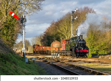 QUORN AND WOODHOUSE, LEICESTERSHIRE, UK - JANUARY 28, 2018: Steam locomotive LMS Ivatt Class 2 2-6-0 No. 46521 hauls a freight train into Quorn during the Great Central Railway's  Winter Steam Gala.