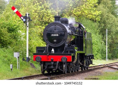 QUORN AND WOODHOUSE, LEICESTERSHIRE, UK - MAY 22, 2016: Steam locomotive S&DJR Fowler 2-8-0 Class 7F No. 53808 pulls away from the unchecked signal at Quorn during the GCR's  Railways at Work Gala.