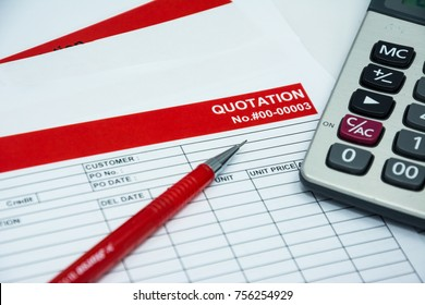 Quotation business document on paper background with res pen and calculator