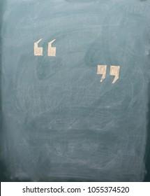 quotation mark on blackboard