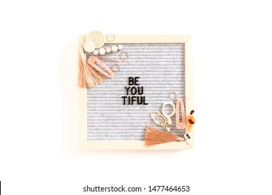 Quote Be You Tiful. Composition with letterboard, earrings, hairpins, rings on white background