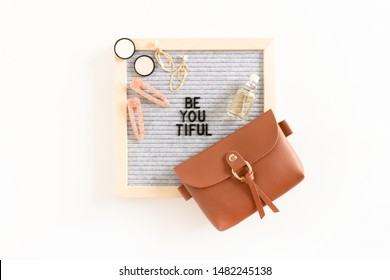 Quote Be You Tiful. Composition with letterboard, handbag, cosmetics and accessories on white background