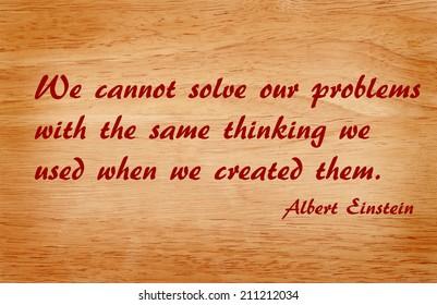 Quote by Albert Einstein on wooden background