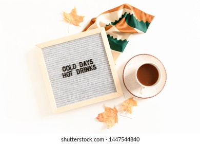 Quote Cold days hot drinks. Flatlay of letterboard, handkerchief, mug of coffee, dried maple leaves on white desk