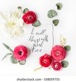 "Quote ""Do small things with great love"" written in calligraphic style on paper with pink, red roses, ranunculus, white tulips and green leaves on white background. Flat lay, top view"