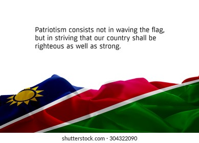 "Quote ""Patriotism consists not in waving the flag, but in striving that our country shall be righteous as well as strong"" waving abstract fabric Namibia flag on white background"